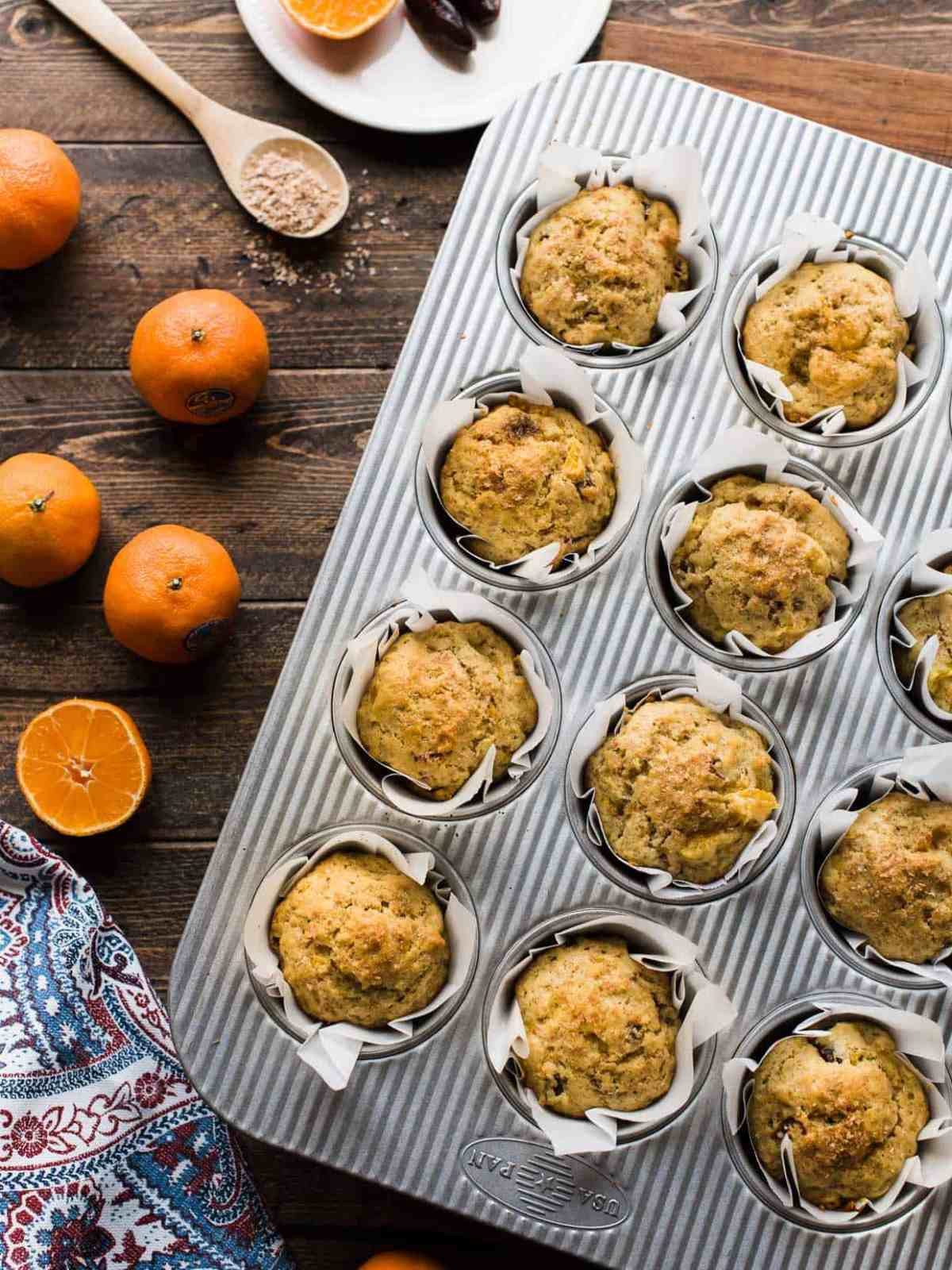 Overhead shot of mandarin orange ginger date muffins made with Wonderful Halos.