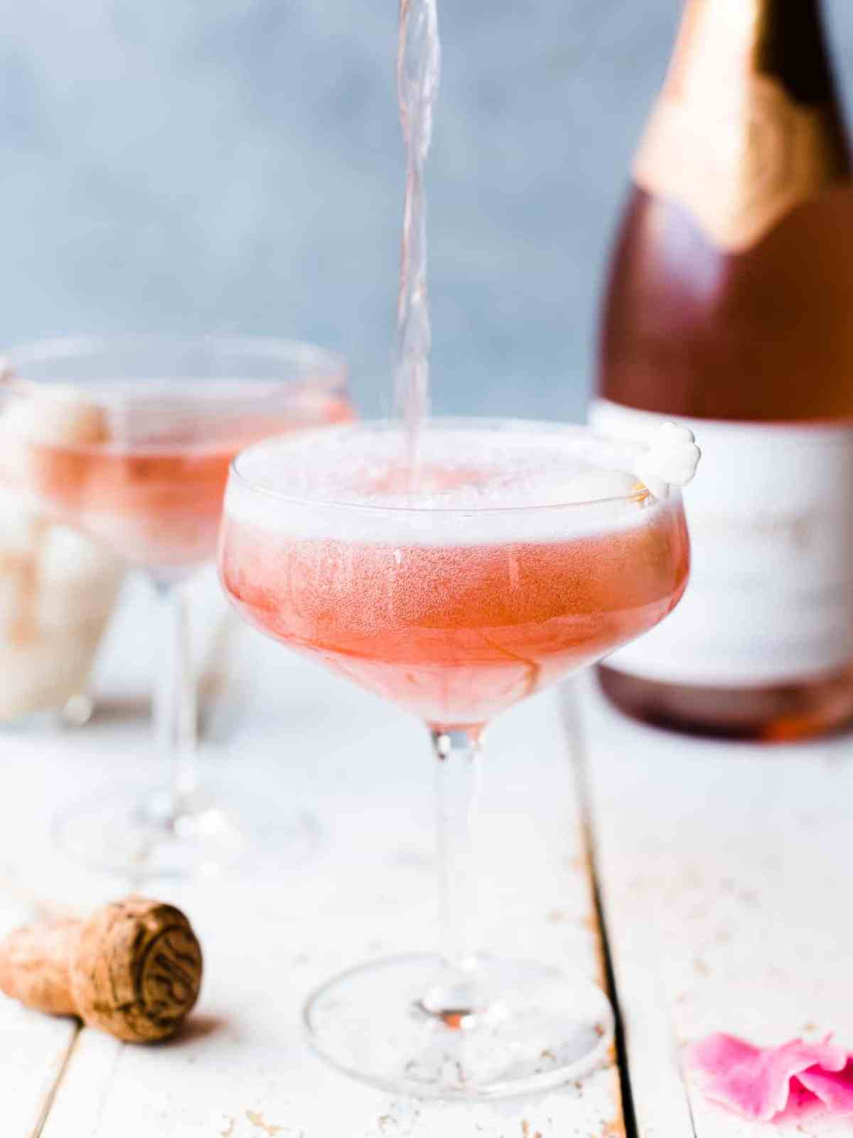 pink lychee rose mimosa with sparkling wine pouring into glass
