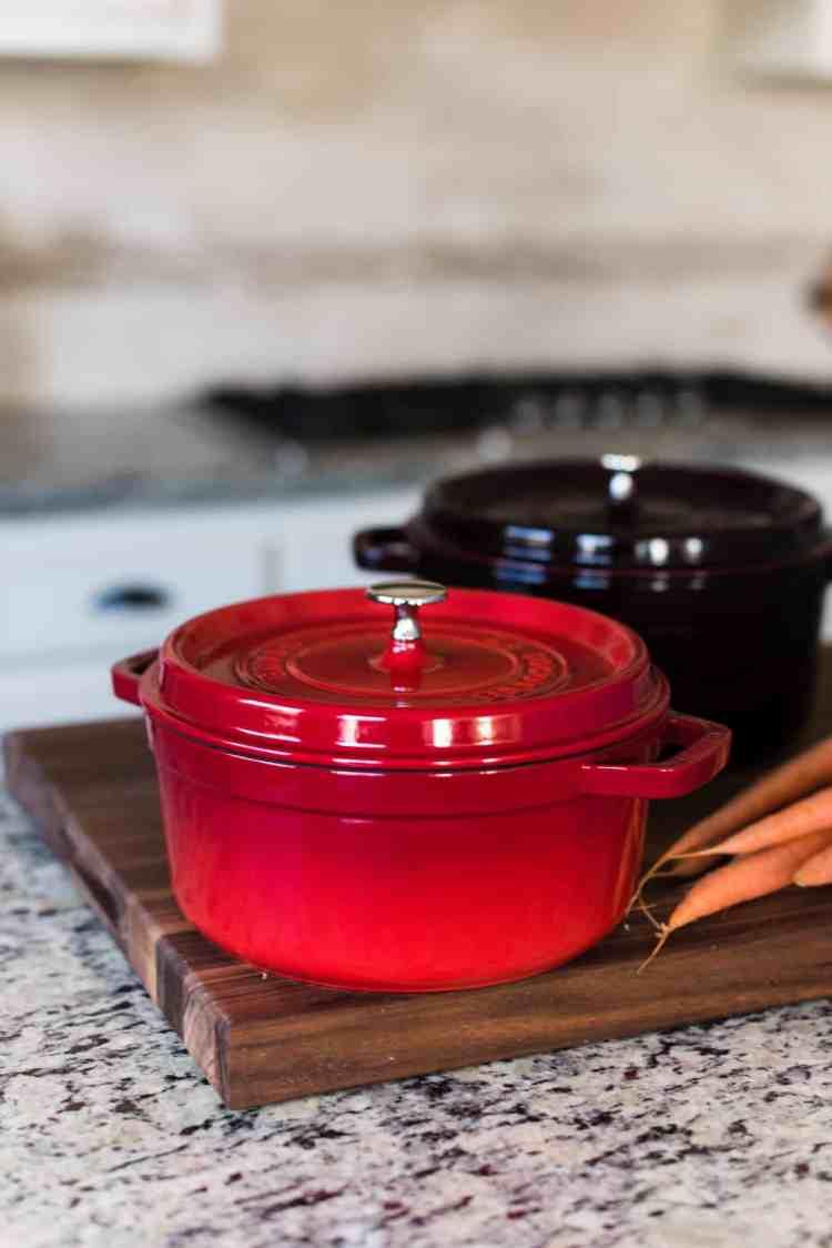 Red Dutch oven in kitchen.