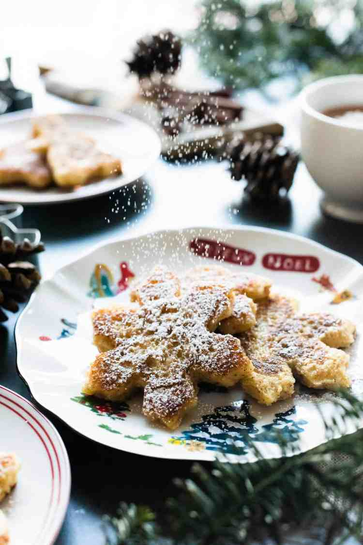 Sprinkling powdered sugar on Gingerbread French Toast.