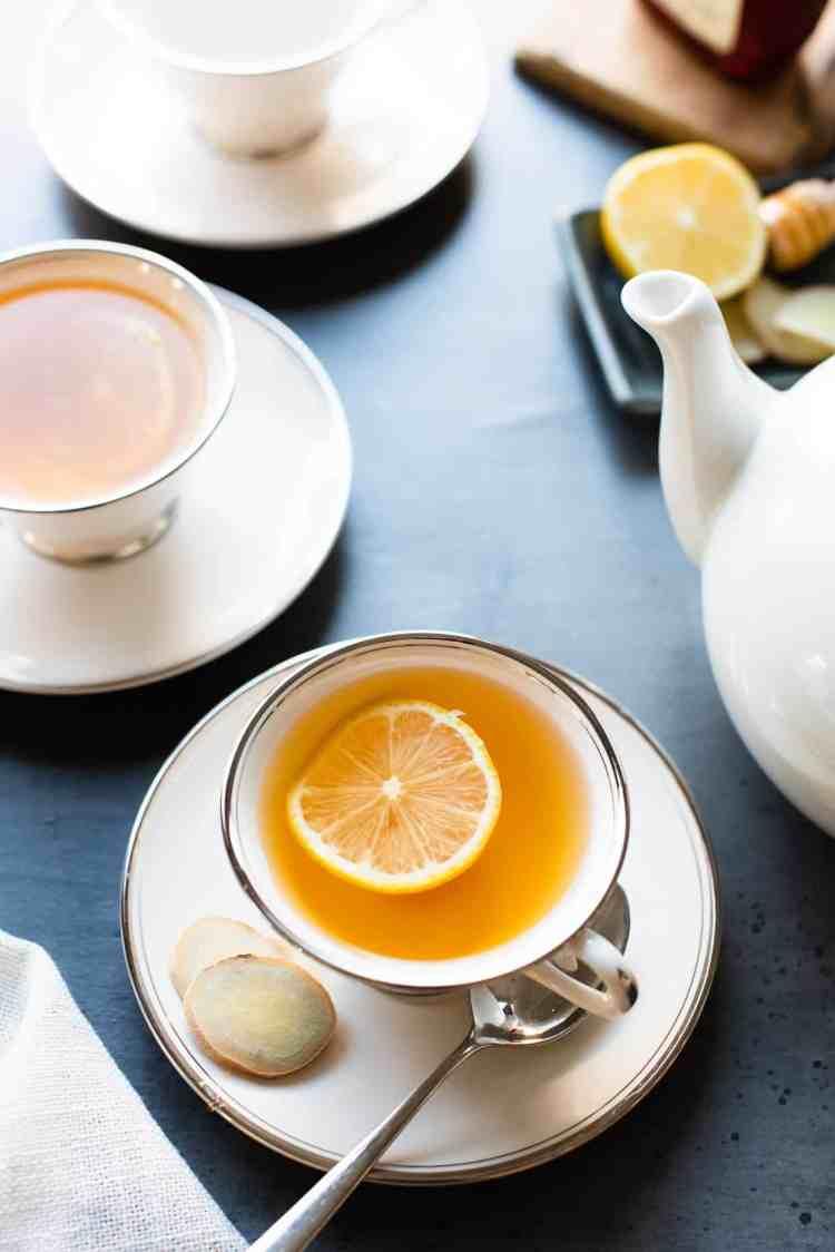 Homemade Fresh Ginger Tea with a slice of lemon in tea cups.