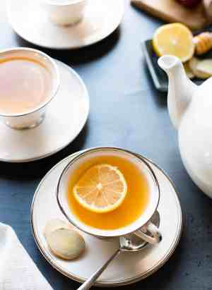 Homemade Fresh Ginger Tea with a slice of lemon in tea cups.