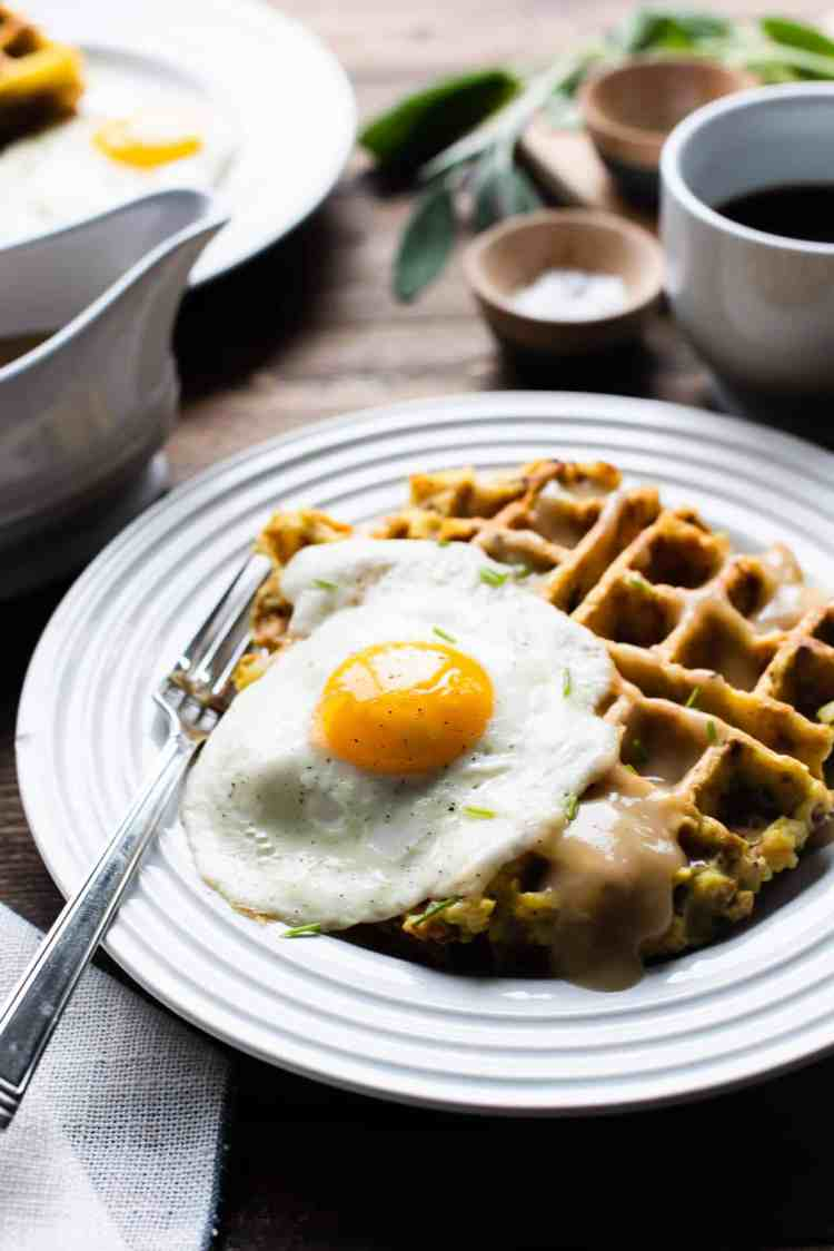 Mashed Potato and Stuffing Waffles served with eggs and gravy.