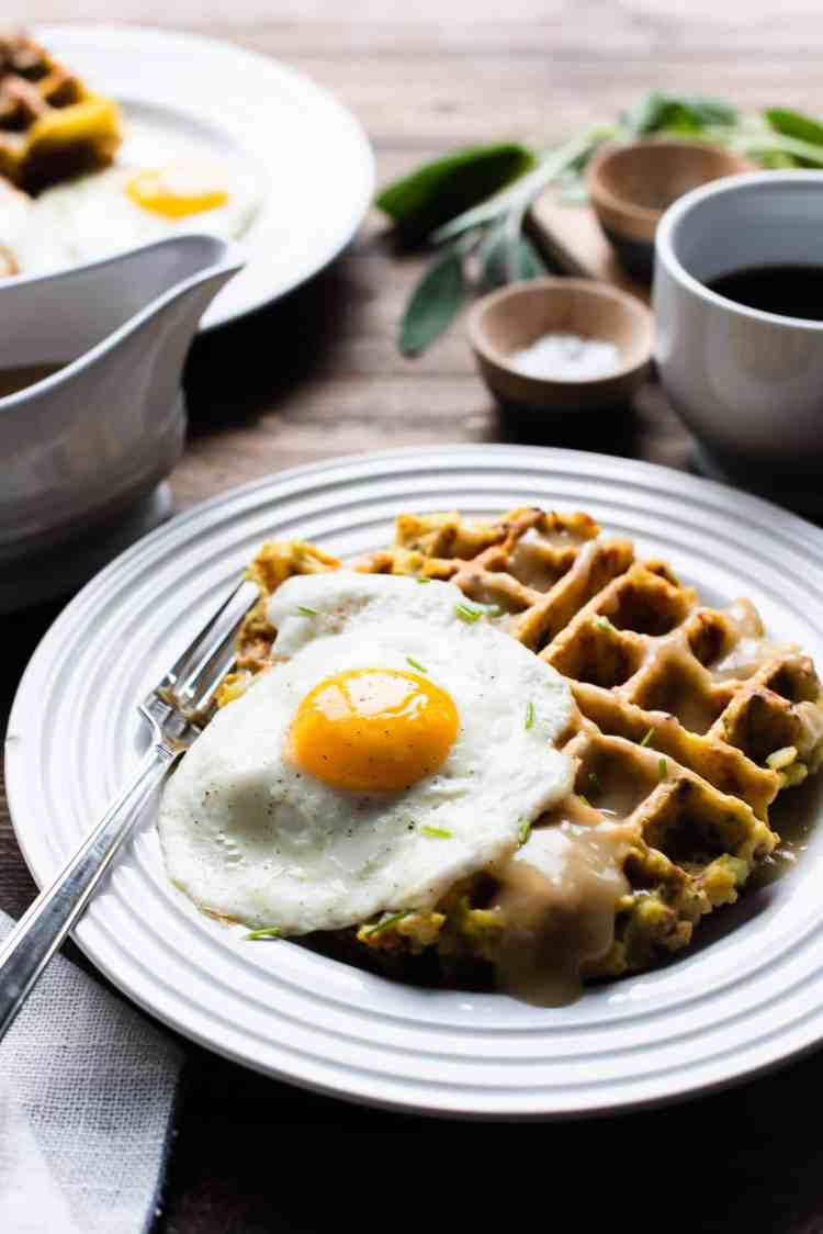 Mashed Potato and Stuffing Waffles served with a sunny side up egg and gravy.