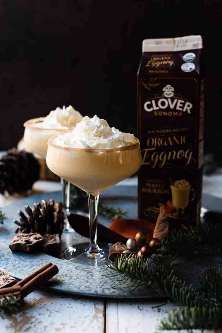 Glasses of Maple Bourbon Eggnog from Clover Sonoma with whipped cream.