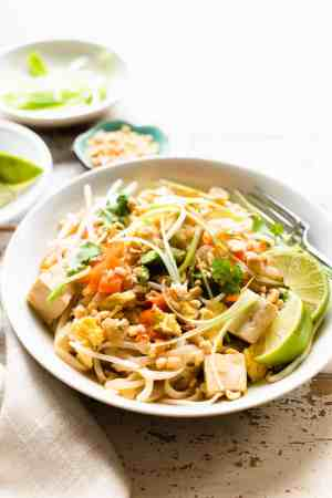 Instant Pot Vegetarian Pad Thai in a serving dish garnished with scallions and cilantro.