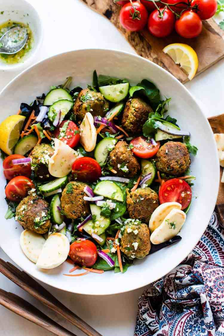 Falafel Salad with Lemon Garlic Dressing in a white bowl.