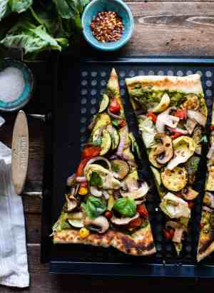 Slices of grilled vegetable pizza on a grill pan.