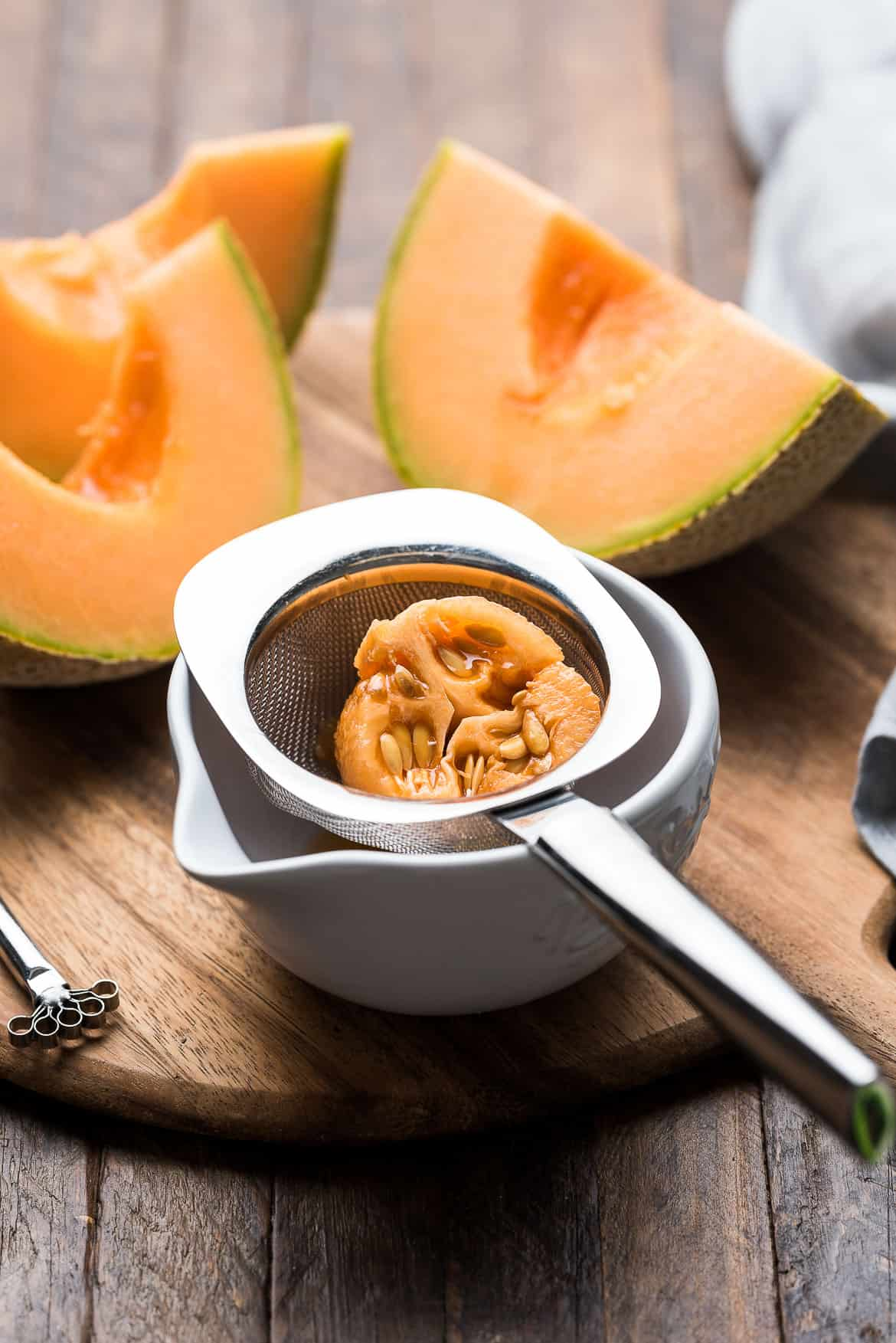 Straining seeds and pulp for Cantaloupe Juice (melon sa malamig)
