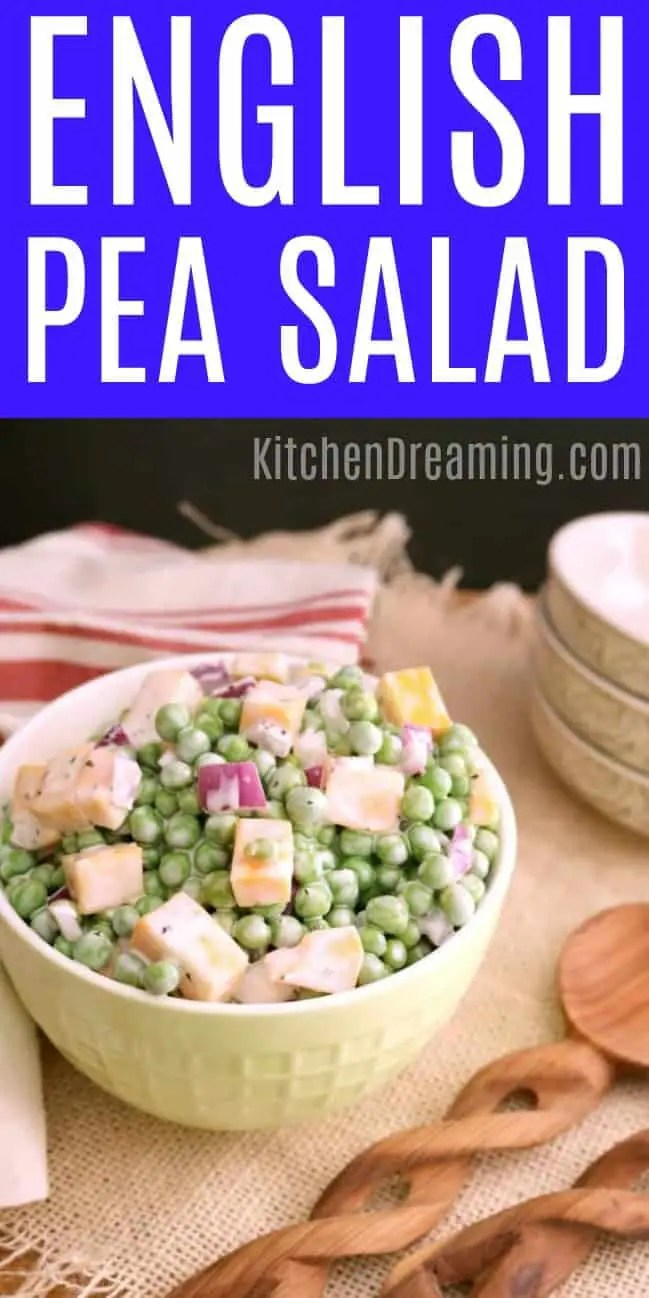 A bowl of English Pea Salad on a woven mat with wooden serving spoons, dishes and napkins in the background.