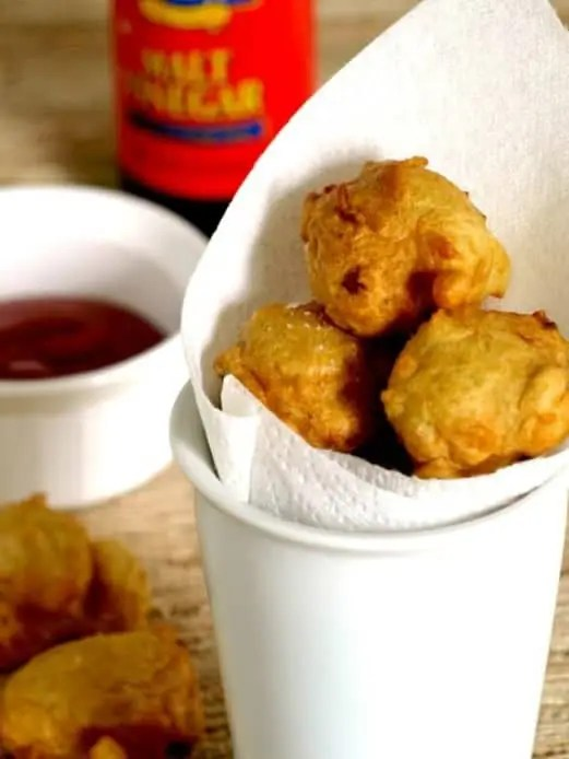 clam cakes in a cup lined with paper towels to drain any oil.
