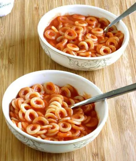 Homemade Spaghettios in a bowl on a wooden board