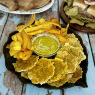 Homemade Green Plantain Chips with Mojo Vinaigrette are so easy to make and are reminiscent of the style chips served in the Cuban cafes