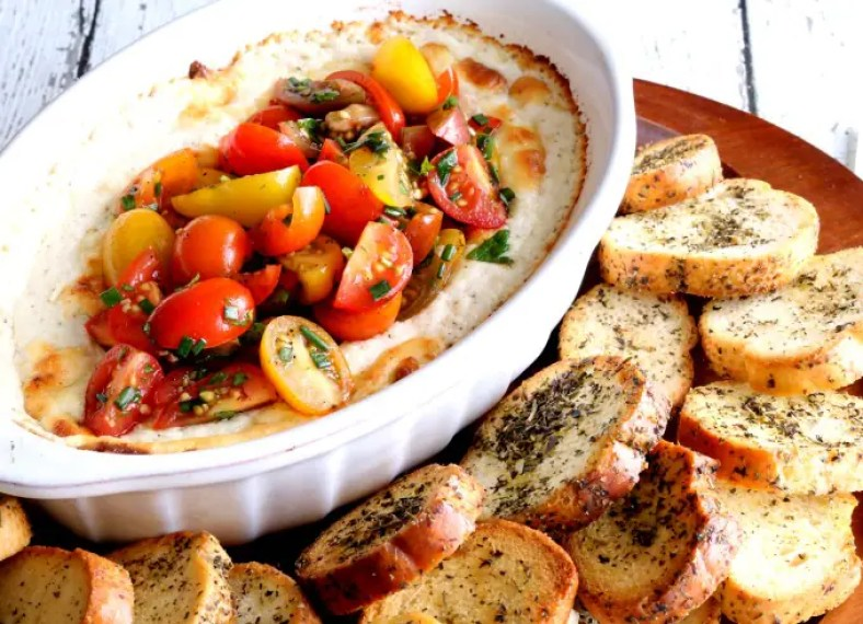 Baked Goat Cheese Dip is quick and simple to make and is perfect for entertaining or as the appetizer for a date night meal.