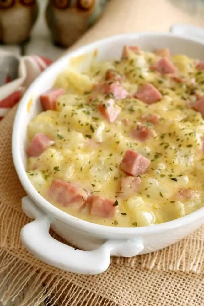 close up shot of a casserole dish filled with stovetop scalloped potatoes.