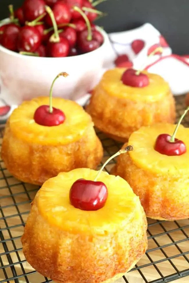 Pineapple upside-down cakes on a cooling rack
