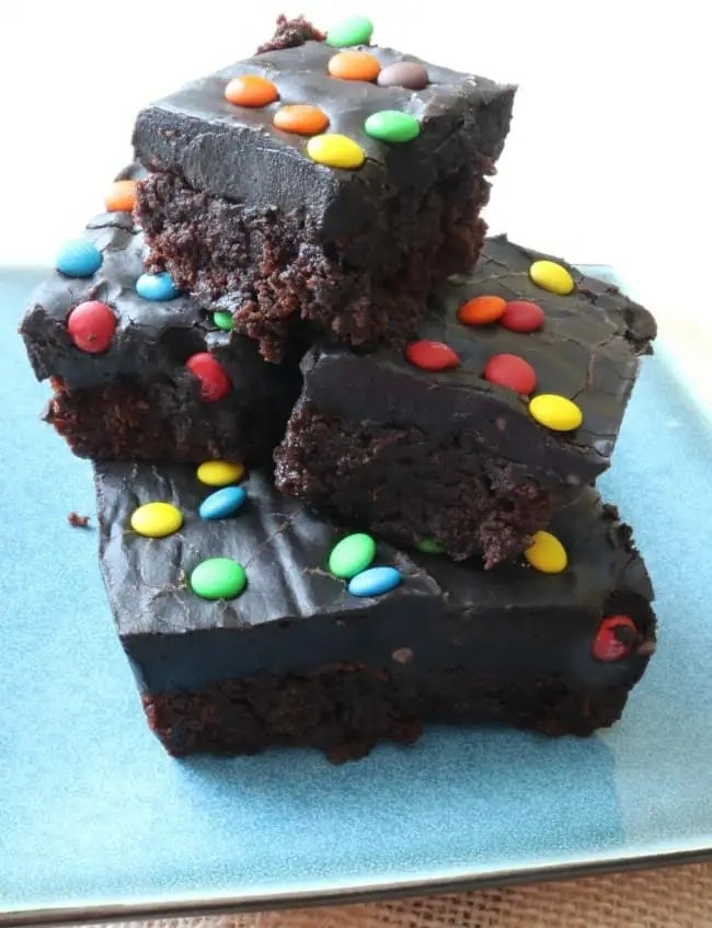These chocolate ganache brownies start with a rich fudge brownie base and are topped with a decadent dark chocolate brownie frosting.