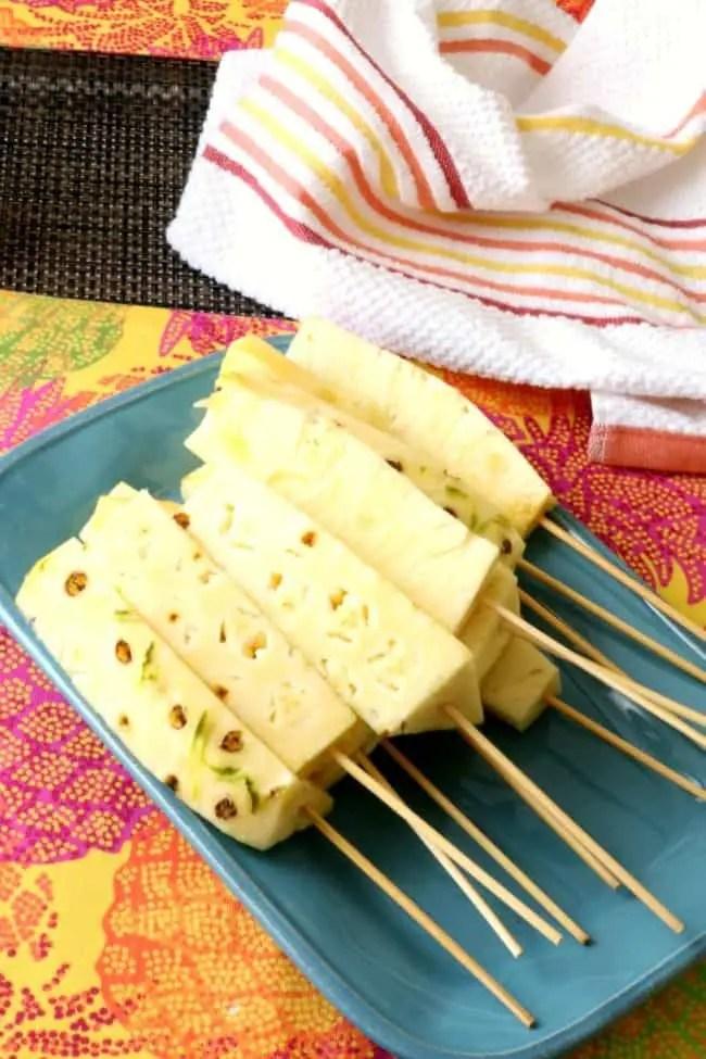 Fresh;y cut pineapple on wooden skewers