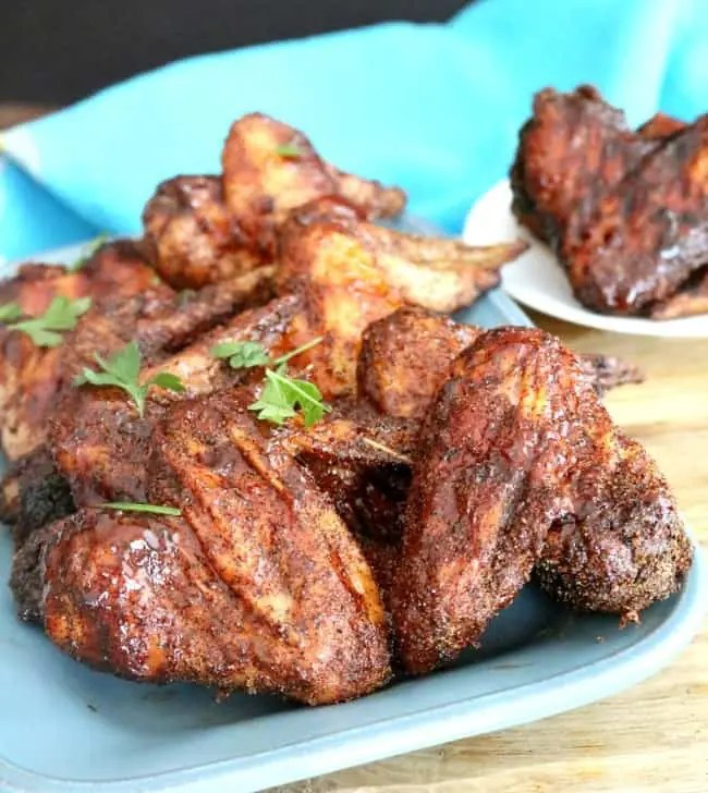 America loves to barbecue and one of my favorite things is grilled BBQ chicken wings. It's one of my favorite ways to cook chicken. Smoking the chicken is a great way to add even more flavor to this summer favorite. Even if you do not own a smoker, you can still smoke these wings like a pitmaster using your grill - and it's easier than you think!