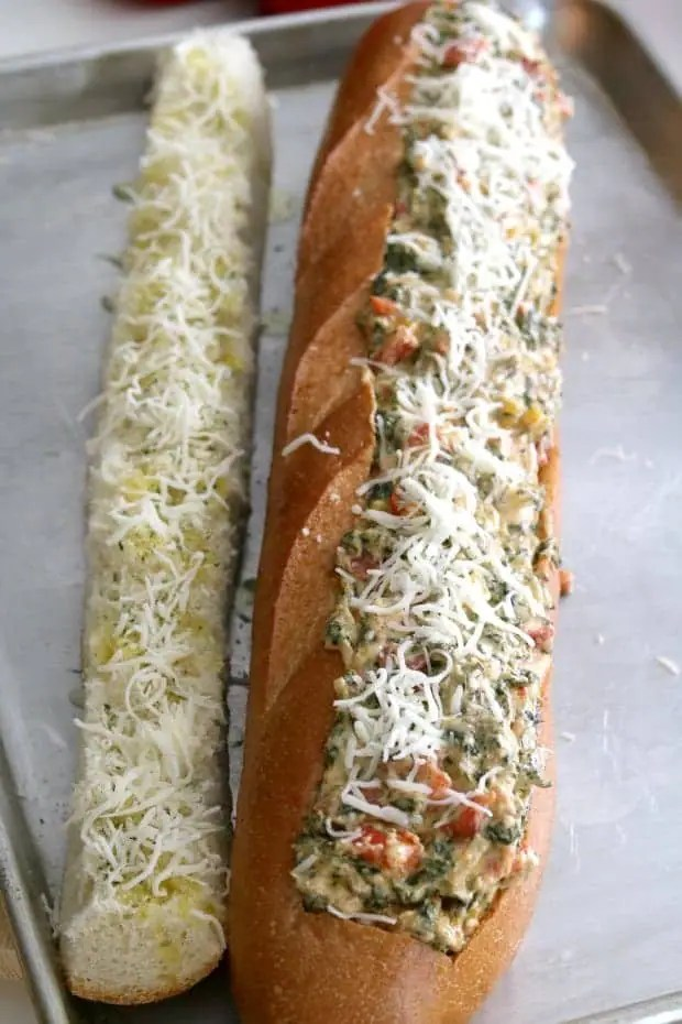 Spinach Dip Stuffed French Bread is hot and melty, ooey and gooey, carb-y and delicious. That's why Spinach Dip stuffed French Bread is the perfect party appetizer! #Party #Appetizers #Vegetarian #Holiday #Ideas