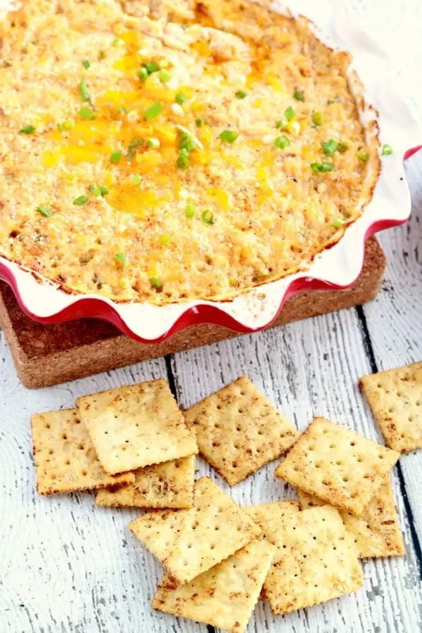 Hot Crab Dip in a stoneware bowl with old bay crackers.