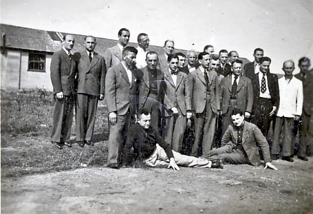 Leo Rosengarten, Kitchener camp 1939, possibly hut 23. Leo is on the left of the picture at the end of the front row, just behind one of the men reclining on the ground