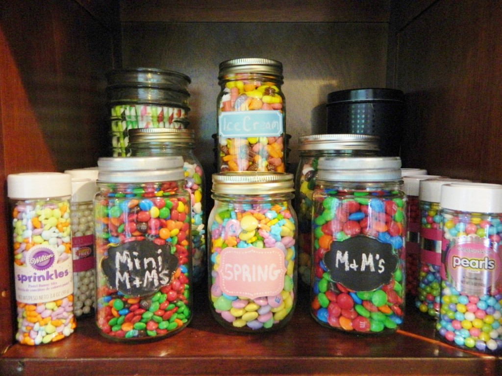 We have different candy, sprinkles, decorative straws, & sticks in the top of the cabinet. We use mason jars with the labels written in chalk for lots of them