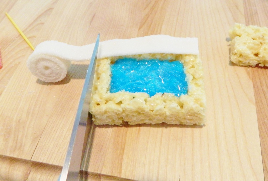 Cut the white candy strips to fit on top using kitchen scissors