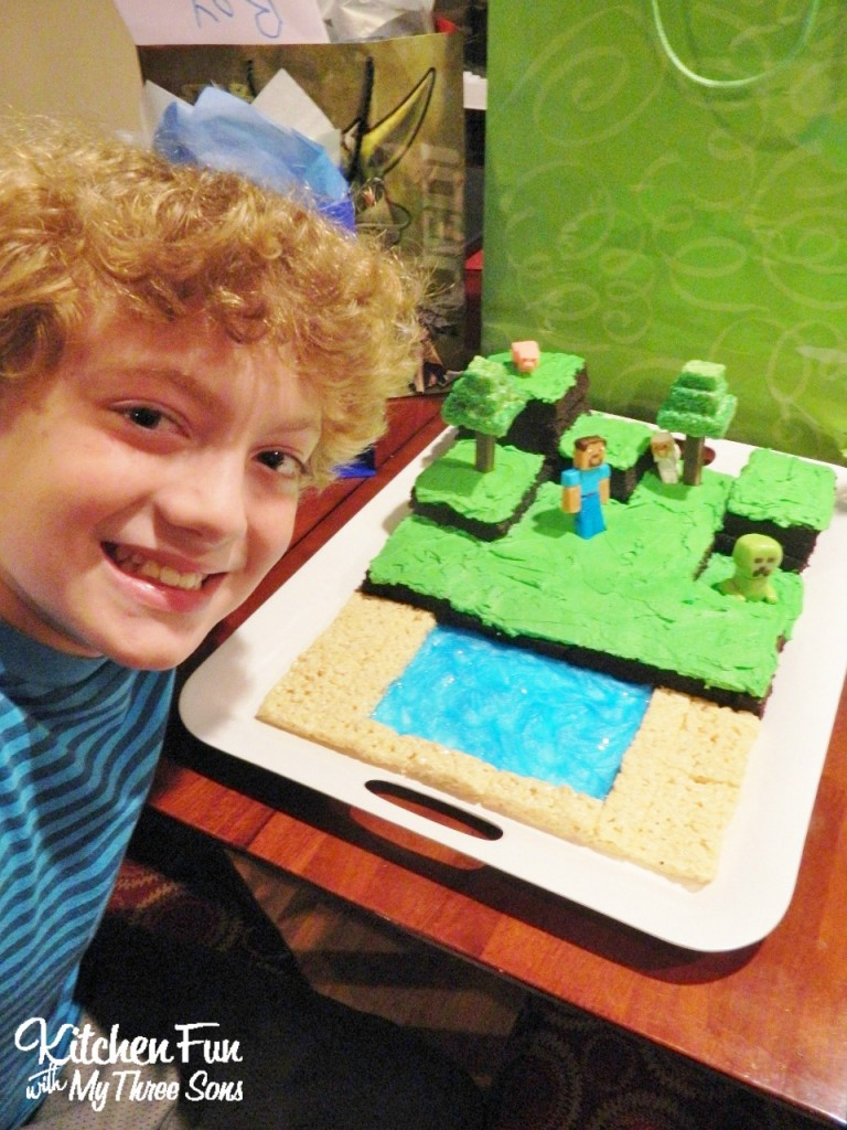 Here is my big birthday boy with his Minecraft Cake!