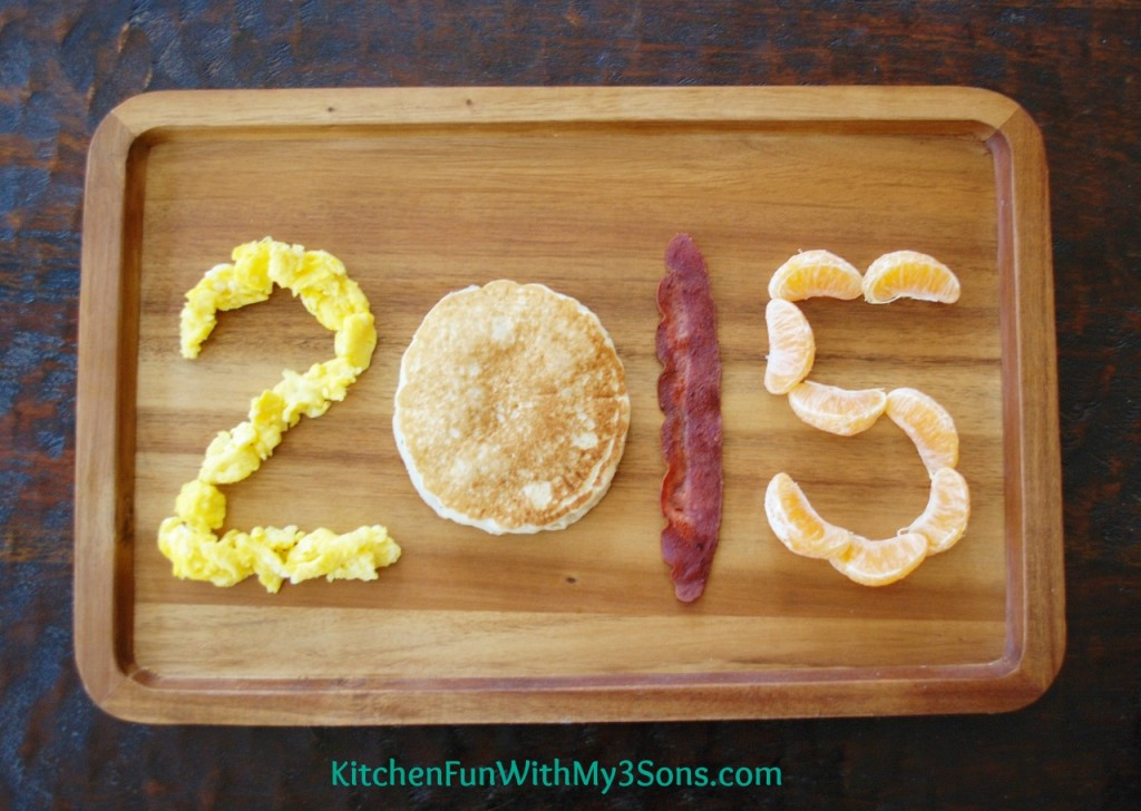 New Year's Breakfast made with pancakes, eggs, and fruit