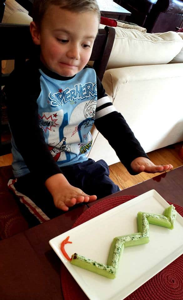 Celery Snake Snack...a great way to get the kids to eat a healthy afternoon snack! KitchenFunWithMy3Sons.com