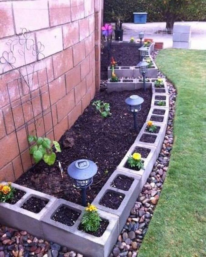 Use cinder blocks for edging around a garden flower bed...these are the BEST Garden Ideas!