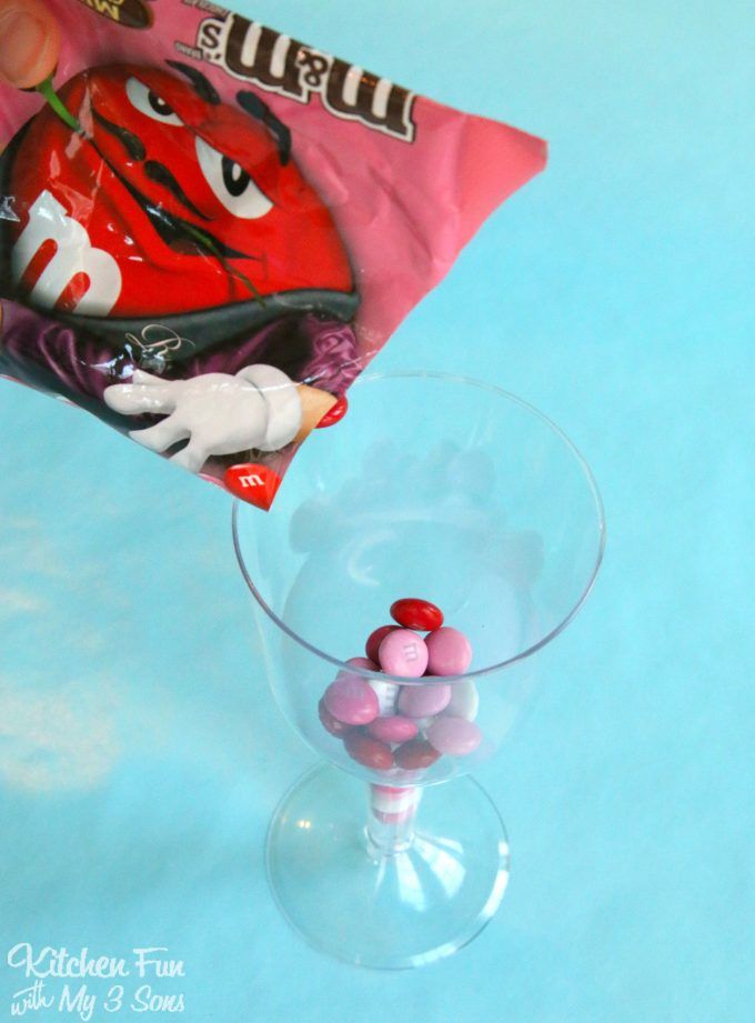 Valentine Cupcakes served in Plastic Wine Glasses filled with Candy! Such a fun idea for the Kids for Valentine's Day!