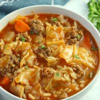 Cabbage Roll Soup with beef and chopped veggies is a delicious dinner recipe that will warm your belly on a cold and crisp fall day.