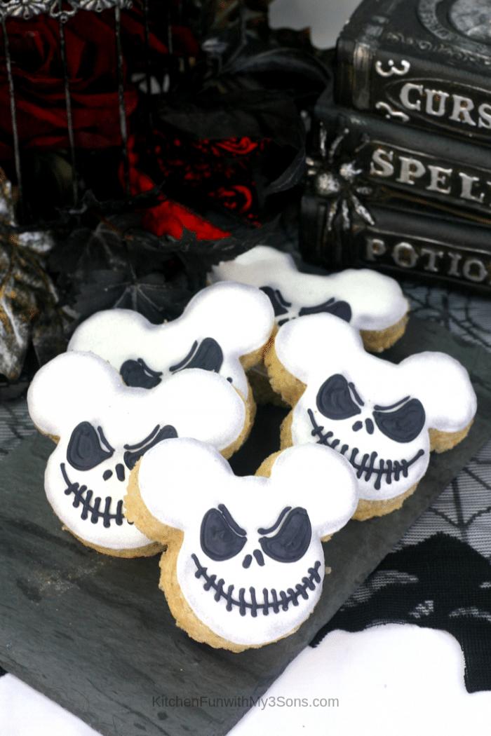 Jack Skellington Mickey Mouse Rice Krispie Treats recipe sitting on a black napkin in front of spooky books