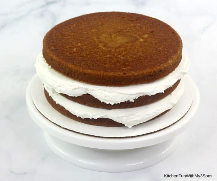 Layering gingerbread cake for gingerbread layer cake with icing between layers