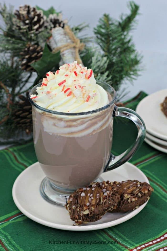 Tall clear mug of boozy peppermint mocha