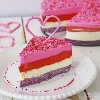 Valentines Cheesecake is a triple layer dessert with a cookie crust. It's easy to make, it's no-bake, and it's frozen, so you can make it ahead and serve it when you're ready.