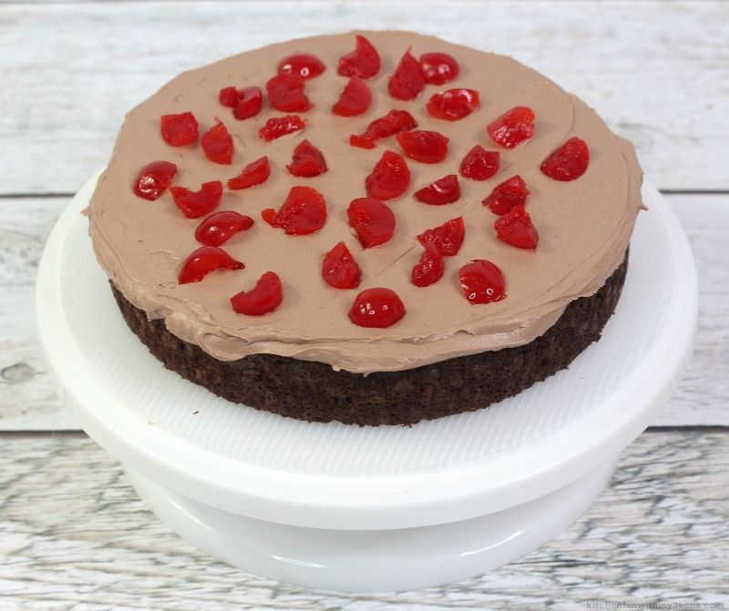 chocolate cake with chocolate frosting and cherries