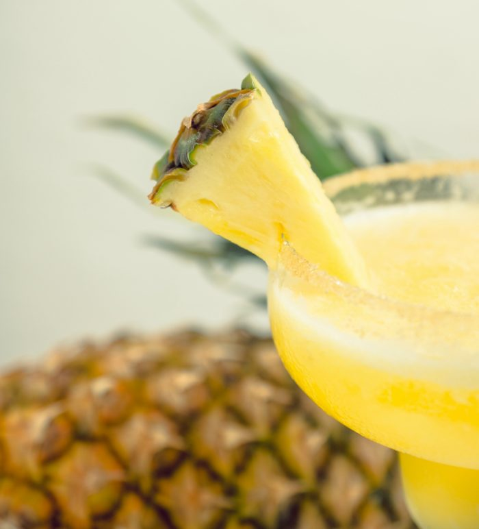 pineapple slice on the rim of a glass