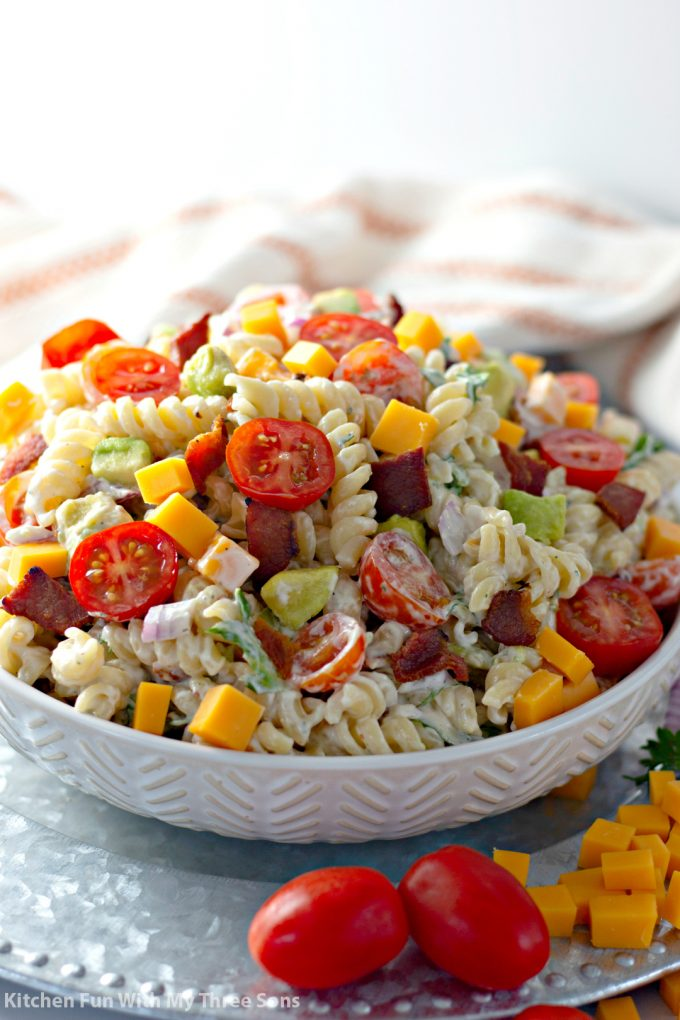 BLT Pasta Salad Recipe in a white bowl on a metal platter