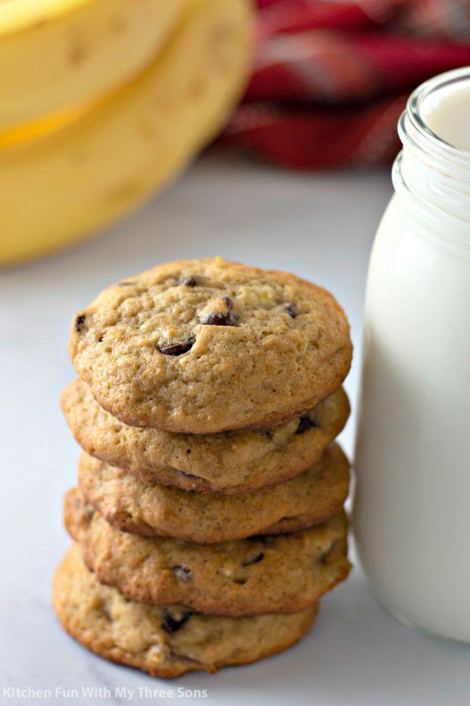 stacked Banana Chocolate Chip Cookies next to milk