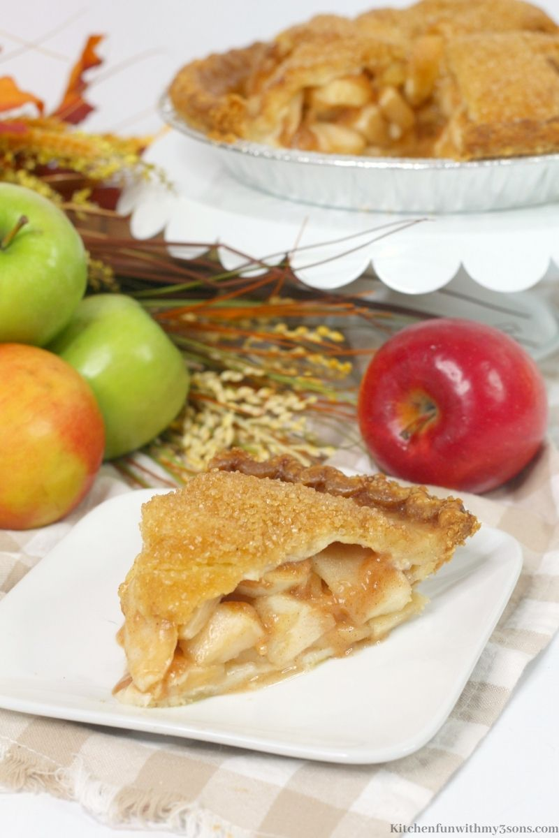 A slice of the Bourbon Apple Pie on a serving plate.