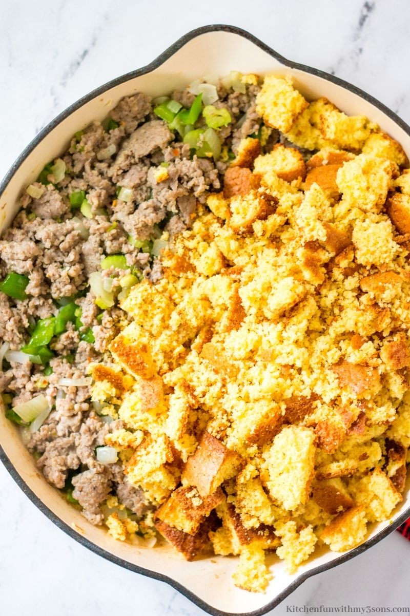 The crumbled cornbread added to the prepared meat and veggies.