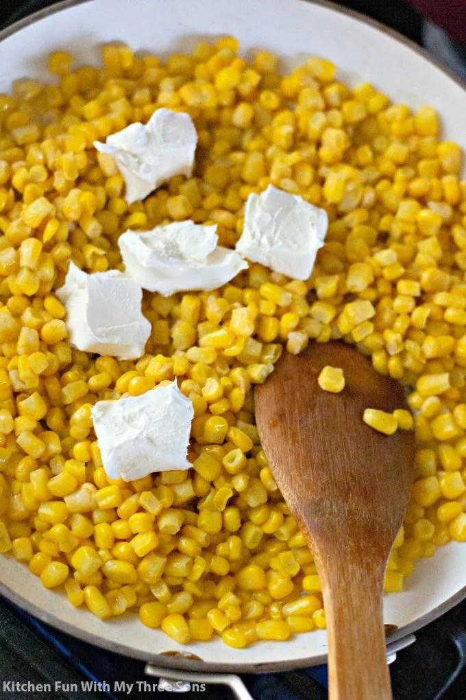 melting cream cheese into the corn