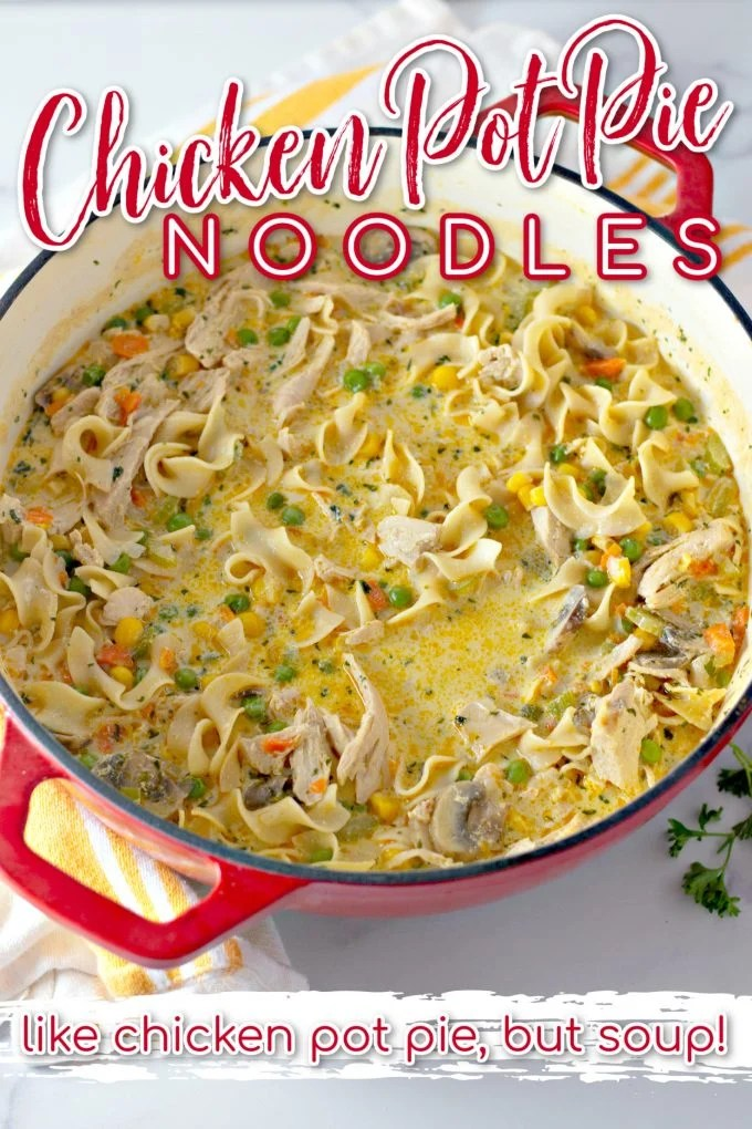 Chicken Pot Pie Noodles in a red Dutch oven with a white and yellow towel