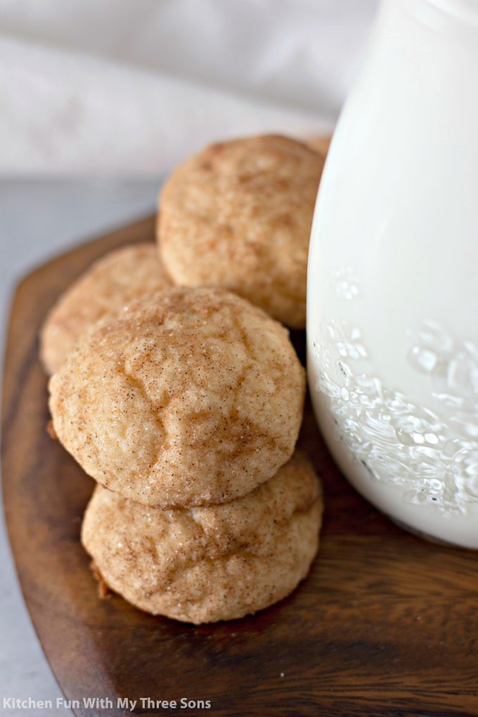 stacked Cinnamon Cream Cheese Cookie Puffs next to a jar of milk