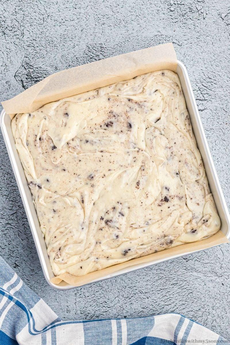 Adding the fudge to the prepared pan.