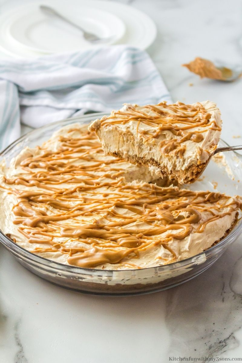 Creamy Peanut Butter Pie Recipe in the pie dish with a slice taken out.