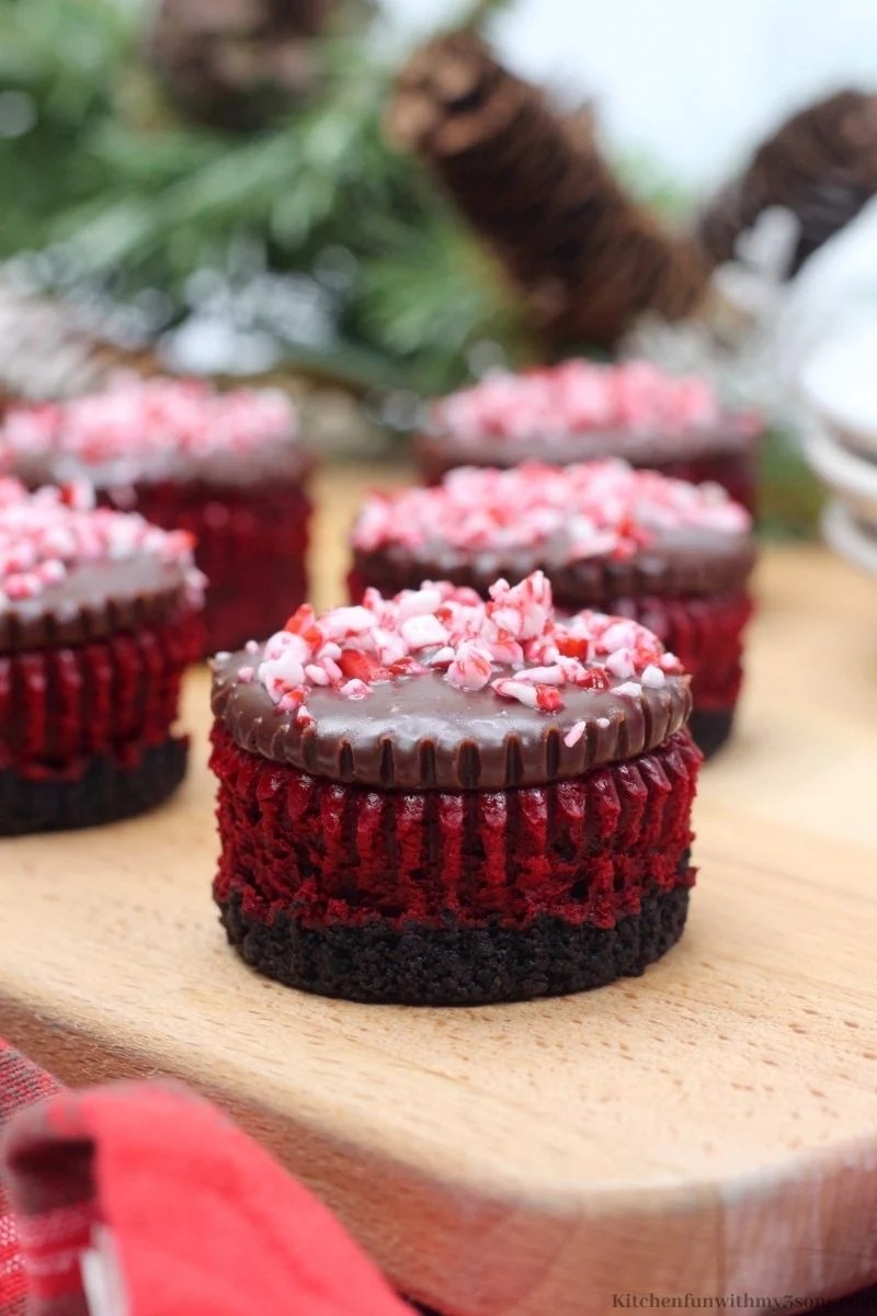 Mint Red Velvet Mini Cheesecakes Recipe on a wooden board.